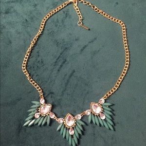 Gold and green statement necklace.